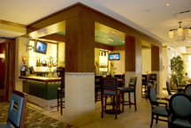 Hotel lounge features Bonier's craftsmanship in column custom woodwork, molding, and column paneling rejuvenation.