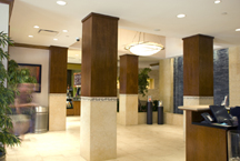 Hotel lobby features a combination of stone, tile, and wood paneled columns that add a professional yet distinctive charm to the character of this urban center hotel.