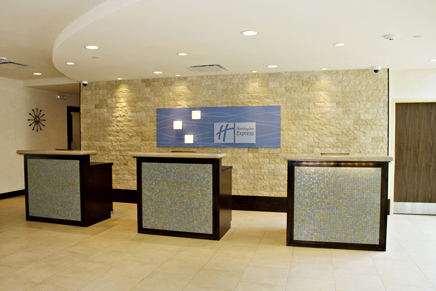 Hotel Reception Desk contruction using wood capentry, millwork, and finishing, and granite countertops, custom tile facing, and decorative accent lighting installtion to form an open, personalize reception for guests.