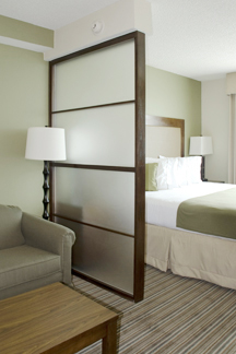 Custom wood and glass room dividers by Bonier enable owners to provide guests personal space within guest room.