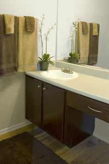 Bathroom vanity and sink countertop resurfacing and cabinet and drawer refinishing for multi-unit apartment complex.