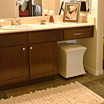 Bathroom vanity features new granite countertops and true to theme refinished windowpane style cabinetry