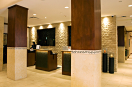 Custom built hotel reception stations and custom millwork for molding, window frames, and column paneling.