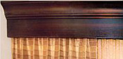Distinctive upscale wood valences for hotel guest rooms.