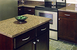 Apartment development kitchen remodeling with solid granite countertops for cabinets and island, and stained and varnished refinished cabinets and doors with brushed nickel knobs and handles