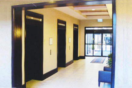Elevator entrance and lobby doorway custom millwork molding and installation by Bonier.
